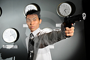 Asian Man In Office With A Gun Stock Photos - Image: 17571443