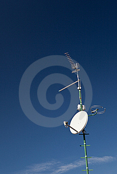 Antennas And A Satellite Dish On A Roof Royalty Free Stock Image - Image: 17594026