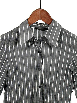 Gray striped shirt on wooden hanger