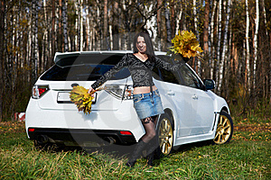 Joyful Girl With Yellow Leaves And White Car Stock Photography - Image: 17607552