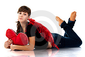 Beautiful Girl Lying With Heart Shaped Red Pillow Royalty Free Stock Images - Image: 17631199