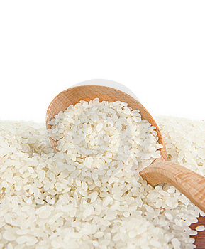 Rice Grain In Wooden Spoon Isolated On White Stock Images - Image: 17664284