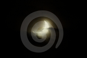 Partial Eclipse Of The Sun With Clouds Royalty Free Stock Images - Image: 17671469
