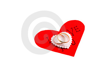 Wedding Rings On The Heart Stock Photos - Image: 17676813