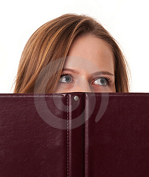 Young Woman Hides Her Mouth Behind The Book Stock Photography - Image: 17682392