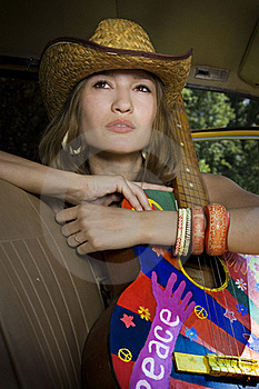 Girl Sitting In The Car With A Guitar Royalty Free Stock Photography - Image: 17682837