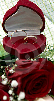 Wedding Rings On Bouquet Of Red Roses Royalty Free Stock Photos - Image: 17685198
