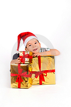 Little Boy In Santa Hat With A Bunch Of Gifts Royalty Free Stock Image - Image: 17686776