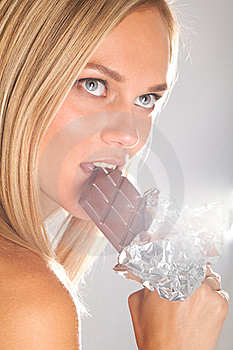 Sexy Woman Eating Chocolate Stock Photography - Image: 17687792