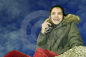 Smiling Girl With Mp3 Royalty Free Stock Image - Image: 1779776