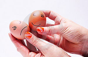 Two eggs in hands Royalty Free Stock Photos