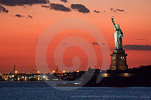 Statue of liberty at dusk Stock Photos