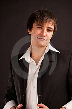 Strong Adult Man With Charming Sight On A Black Ba Stock Photography - Image: 17710012