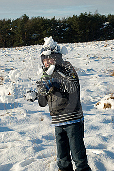 Little Boy Having Fun In Snow With Snowballs Stock Photos - Image: 17724853