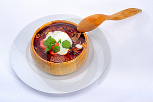 Soup In Wood Plate With Spoon Stock Photo - Image: 17739670