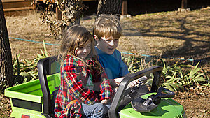 Girl And Boy Riding In A Small Car. Royalty Free Stock Photography - Image: 17744587