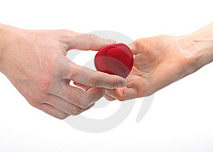 Man's Hand Expanding Heart-shaped Box To Woman's Royalty Free Stock Photos - Image: 17749328