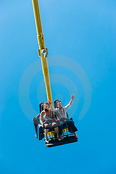Couple Riding On The Attraction Royalty Free Stock Images - Image: 17754149