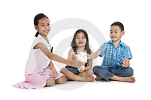 Siblings Cheering With Milk Royalty Free Stock Photo - Image: 17755655
