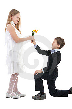 The Boy Gives To The Girl Flowers Stock Photo - Image: 17755840