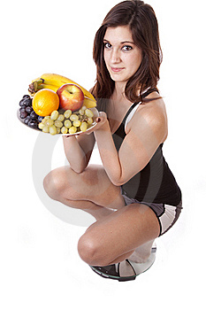 Woman On Scale With Fruit Happy Stock Photography - Image: 17782122