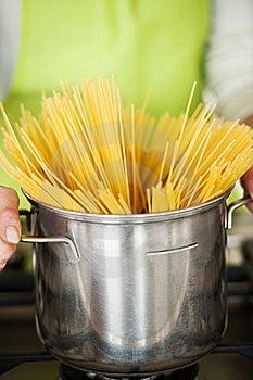 Woman Preparing Spaghetti In Pot Royalty Free Stock Photography - Image: 17796587