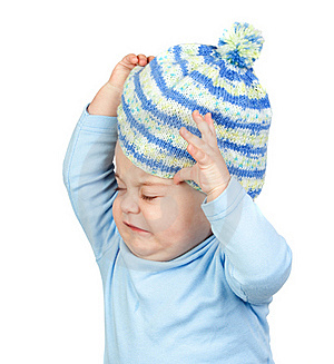 Angry Baby Taking Off A Wool Cap Royalty Free Stock Image - Image: 17836416