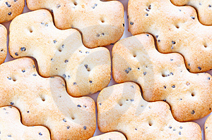 Shaped Browned Crisp Biscuits As Tile Background Royalty Free Stock Photos - Image: 17845038