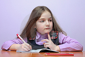 Little School Girl Doing Homeworks At Desk Royalty Free Stock Photos - Image: 17846998