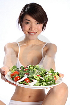 Happy Japanese Girl Holds Plate Of Green Salad Stock Images - Image: 17851154