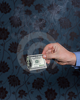 Smoking One Hundred Dollars Bill In Hand Stock Images - Image: 17856474