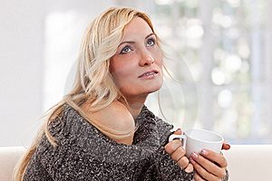 Blondie Woman With An White-colored Cup Royalty Free Stock Image - Image: 17858216