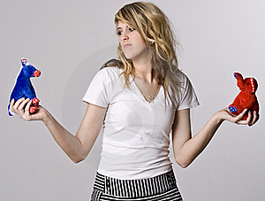 A Blonde Woman Cannot Decide Who To Vote For Royalty Free Stock Images - Image: 17864799