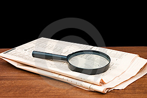 Magnify Glass Over A Of Newspaper Stock Image - Image: 17865481