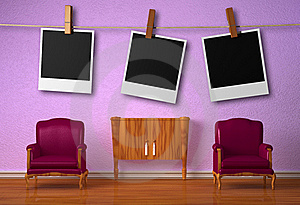 Two Chairs With Console And Hanging Frames Royalty Free Stock Photography - Image: 17865917