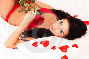 Girl Lying In Bed, Strewn With Hearts And Roses Stock Image - Image: 17892421
