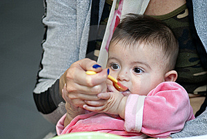 Baby Girl Eating With Her Mother Stock Photo - Image: 17911840
