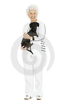 Old Woman With A Dachshund In Her Arms Royalty Free Stock Photos - Image: 17915388
