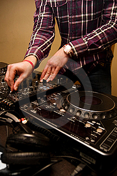 Hands of a Dj playing music Royalty Free Stock Photo