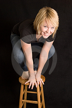 Young Woman On Stool Royalty Free Stock Photo - Image: 17928905
