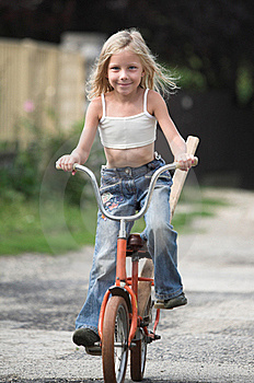 Young Girl Rides Her Bicylce Stock Photo - Image: 17933410