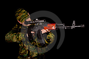Soldier In Uniform With Rifle Stock Image - Image: 17970351