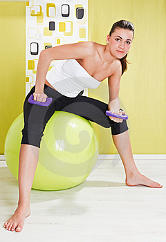 Young Girl Behooves Gym Exercise With Ball Stock Photography - Image: 17971792