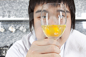 Chef Considering A Glass Of Raw Egg Royalty Free Stock Images - Image: 17973179