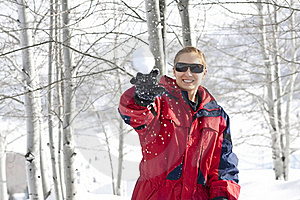 Throwing A Snowball - Winter Fun Royalty Free Stock Photography - Image: 17980497