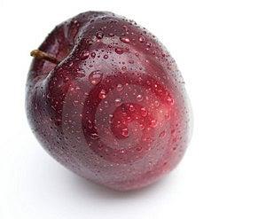 Una manzana al día… Foto de archivo