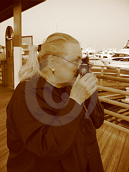 Woman taking a Photo Stock Photos