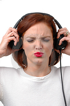 Woman with headphones listening loud to music Royalty Free Stock Photos