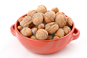 Red bowl with mixed nuts, walnuts, hazelnuts, almonds