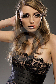 Beautiful Blond Model In Black Dress Stock Images - Image: 18007044